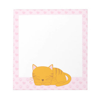 Gato de Tabby anaranjado el dormir Bloc