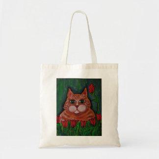 Gato de Tabby y la bolsa de asas anaranjados gordo