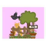 Gato del gatito en el jardín postal