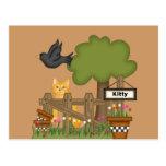 Gato del gatito en el jardín postales