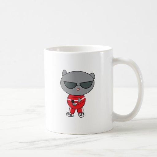 Gato del golpeador en juego de pista tazas de café