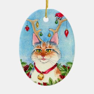 Gato del navidad con el ornamento de las astas del adorno ovalado de cerámica