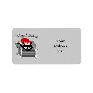 Gato del navidad en una caja de regalo etiquetas de dirección
