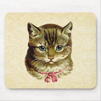 Gato del vintage con el arco rosado tapetes de raton