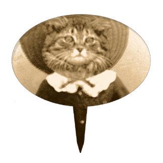 Gato del vintage en el gorra palillos de tarta