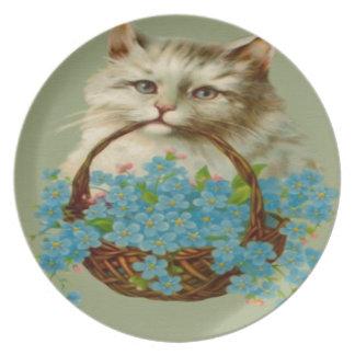 Gato del vintage que sostiene la cesta de flores plato de cena