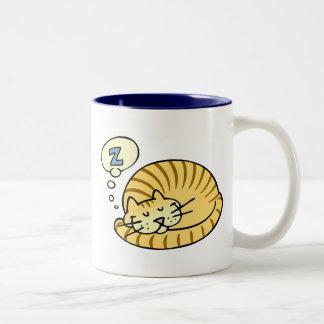 Gato el dormir taza de café