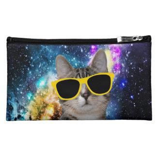 Gato en bolso del cosmético del espacio exterior