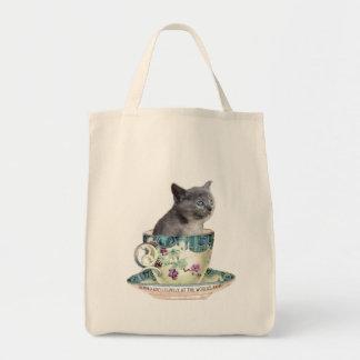 Gato en el bolso de la taza bolsas