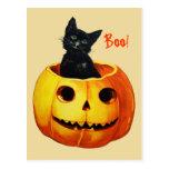 Gato en la postal de Halloween del vintage de la