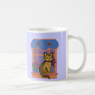 Gato en la taza del Windowsill