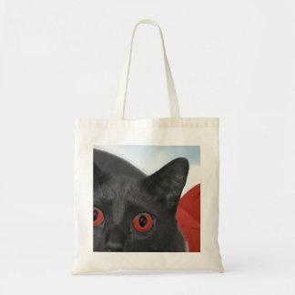 Gato gris con la imagen mezclada ojos del naranja bolsa de mano