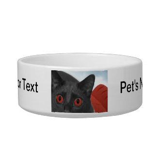 Gato gris con la imagen mezclada ojos del naranja tazon para gato