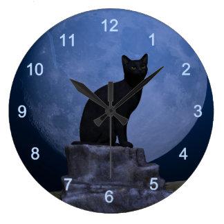 Gato iluminado por la luna reloj redondo grande