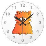 Gato largo anaranjado lindo del pelo relojes de pared