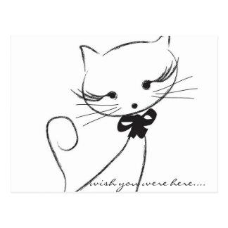 Gato lindo con la postal del arco