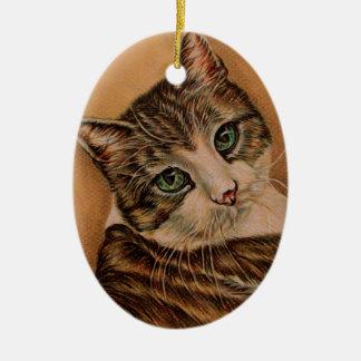 Gato lindo con los ojos verdes y la cabeza adorno navideño ovalado de cerámica