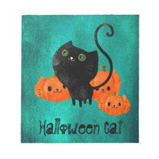 Gato lindo de Halloween con las calabazas Bloc De Notas