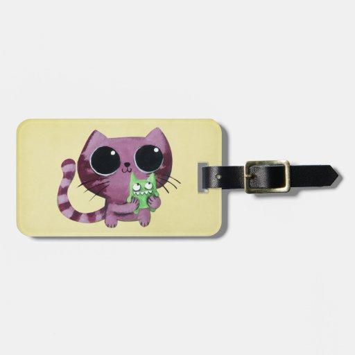 Gato lindo del gatito con el pequeño monstruo etiquetas bolsa