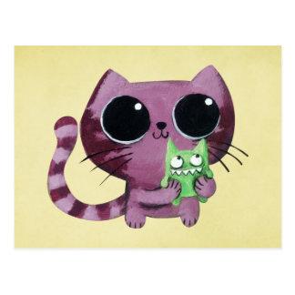 Gato lindo del gatito con el pequeño monstruo postales