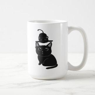 gato-madre y niño negros taza de café