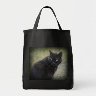 Gato masculino negro con los ojos verdes bolsas de mano