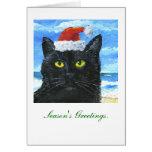 Gato negro con la tarjeta de felicitación del gorr