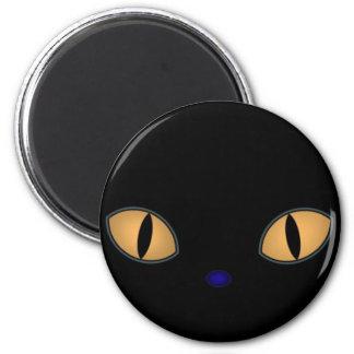 Gato negro con los ojos anaranjados grandes imán redondo 5 cm