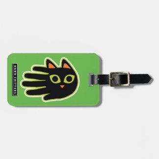 Gato negro con los ojos que miran fijamente etiqueta de equipaje