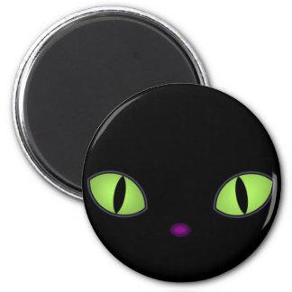Gato negro con los ojos verdes grandes imanes