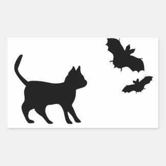 Gato negro con murciélago