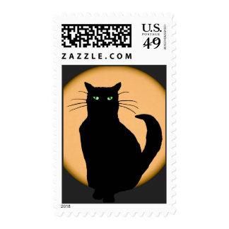 Gato negro contra el sello de levantamiento de la