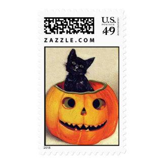 Gato negro de Halloween del vintage en Jack Sello