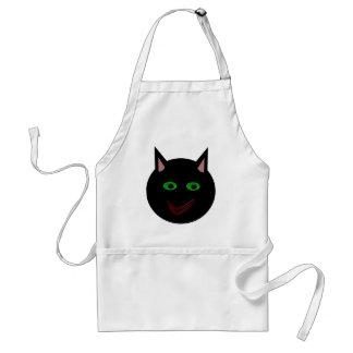 Gato negro de Halloween que cocina el delantal