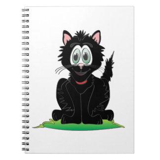 Gato negro del dibujo animado libreta