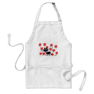 Gato negro del dibujo animado y flores rojas delantal