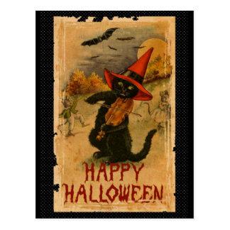 Gato negro del feliz Halloween que juega palos del Postal