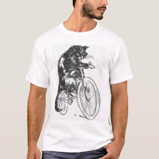 Gato negro del vintage en la bicicleta playera