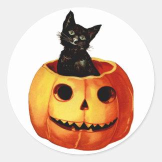 Gato negro del vintage y pegatina de la calabaza