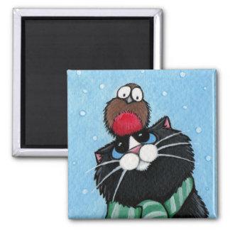 Gato negro e imán festivo del petirrojo
