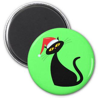 Gato negro en el gorra de Santa Imán