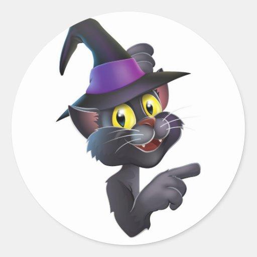 Gato negro en gorra de la bruja pegatinas redondas