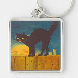 Gato negro en hombre de la cerca en la luna llaveros personalizados