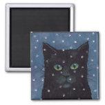 gato negro en nieve del invierno iman de frigorífico
