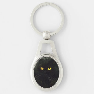 Gato negro llavero plateado ovalado
