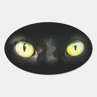Gato negro, ojos verdes amarillos, liso y pegatina ovalada