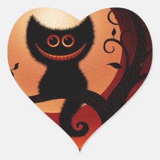 Gato negro sonriente caprichoso pegatina en forma de corazón