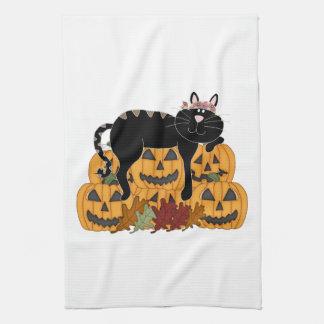 Gato negro y calabazas toalla de mano