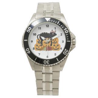 Gato negro y calabazas reloj