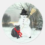 Gato negro y muñeco de nieve pegatina redonda